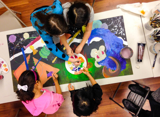 Students working on painting together in Painting Class